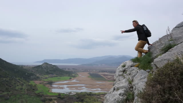 Man hikes above ruins of ancient Greek civilization