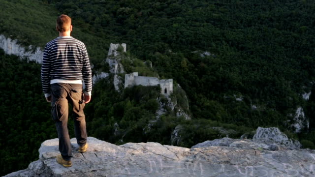 Man hiking to the old fortress