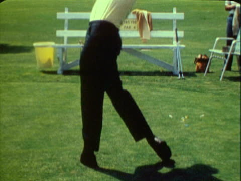MONTAGE Man hitting golf ball with club and golf ball on tee being hit by golf club / United States