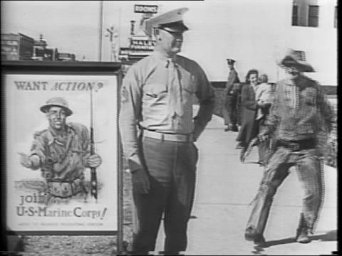 Man holding a newspaper with a headline that reads Cleveland Salutes Army Day camera pans to wide view of Cleveland / a parade procession of military...