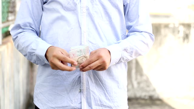 Man holding money for count his currency
