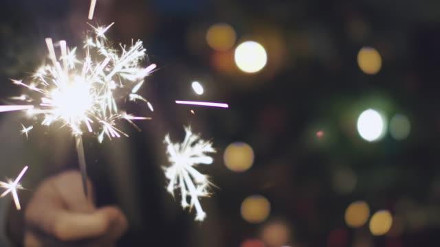 Man holding Sparkler at Christmas
