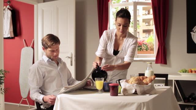 MS TD Man ignoring girlfriend at breakfast table / Berlin, Germany