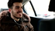 Man in a car with earphones