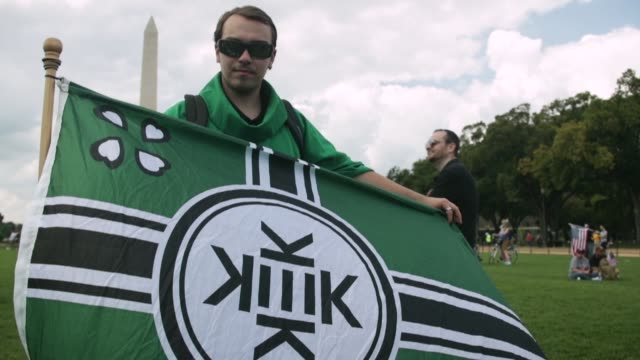 "A man in a green robe discusses the flag of Kekistan a fictional country during a ""Mother of All Rallies"" Hundreds of supporters of US President..."