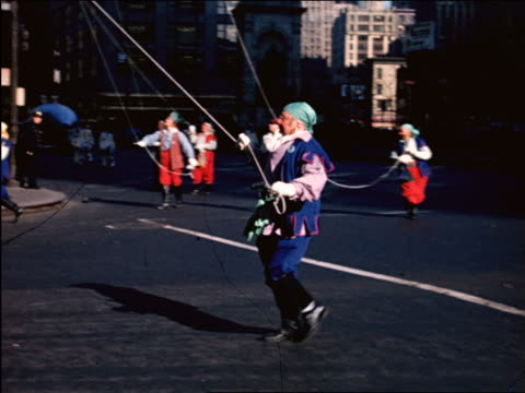 1944/45 man in costume marching with string in Macy's Thanksgiving Day Parade / newsreel