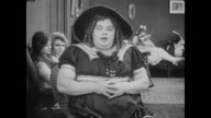 Fatty Arbuckle in drag sits with women in changing room