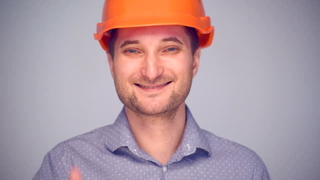 Man in helmet gesturing thumb up sign
