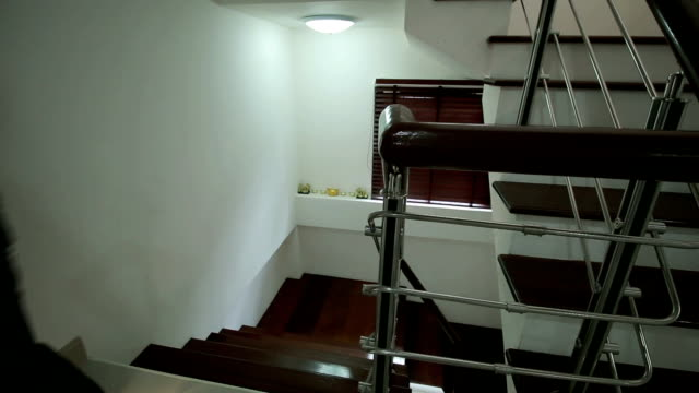 Man in home walk to balcony, Aerial View, Thailand