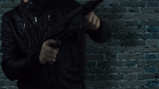 man in leather jacket with machine gun HD