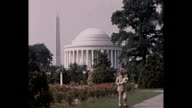 1940 - Man in military uniform with baby at Jefferson Memorial