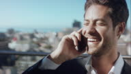 Man in penthouse talking on phone