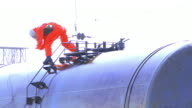Man in Protection Suit cleaning up after chemical accident