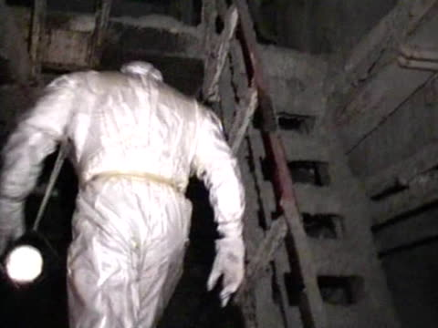 / man in protective clothing inside the active zone of Chernobyl power unit number 4