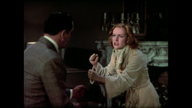 Man (Fredric March) incites weepy woman (Carole Lombard) to try punching him