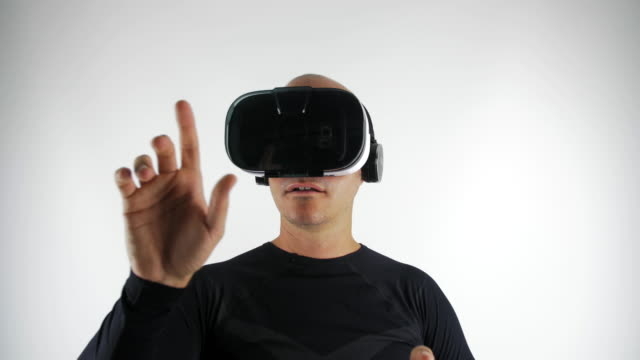 Man interacting with a virtual reality interface screen