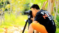 man is shooting a photo
