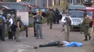 A man is shot and killed by Kenyan police outside the US embassy in the capital Nairobi after stabbing an officer with a knife