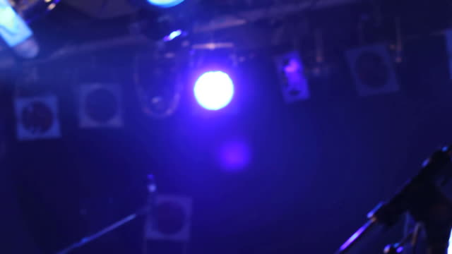 Man is singing on stage. HipHop