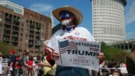 A man is wears the colors of the USA as face paint as Donald Trump supporters hold an 'America First' rally at Settlers Square during the first day...