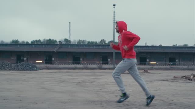 Man jogging in abandoned railway area