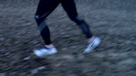 CU, TS, Man jogging in disused quarry, low section, Wales, United Kingdom