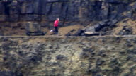 WS, PAN, Man jogging in disused quarry, Wales, United Kingdom