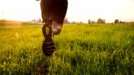 TS Man Jogging Through Wet Grass
