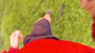 POV Man Jogging Through Wet Grass