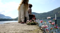 Man joins woman above lake