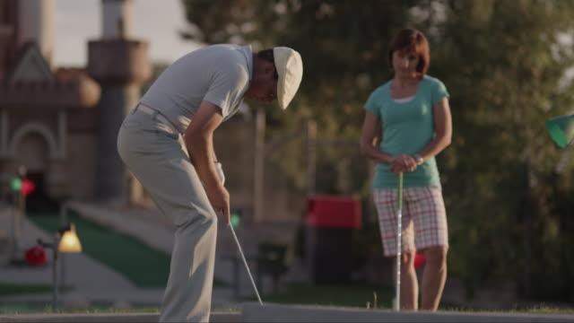 MS TU TS Man jumping and breaking golf club after missing shot / Orem, Utah, USA