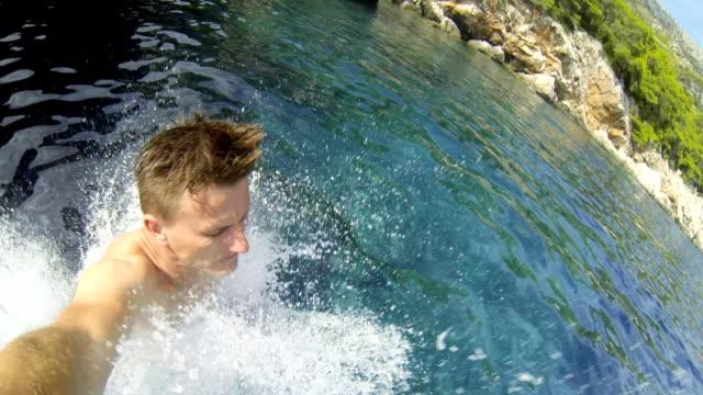 SLO MO POV Man Jumping Into The Sea