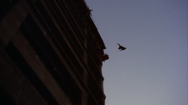 MS TD Man jumping to roof of eleven story under construction building / Los Angeles, California, United States