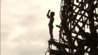 Man jumps off wooden tower during land diving ritual, Pentecost, Vanuatu