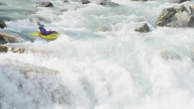 MS Man kayaking off waterfall in white water rapids