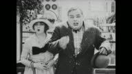 Fatty Arbuckle kicks policeman in rear and blames mean man throwing food