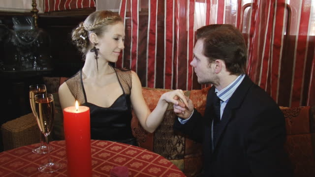 man kisses a young woman's hand