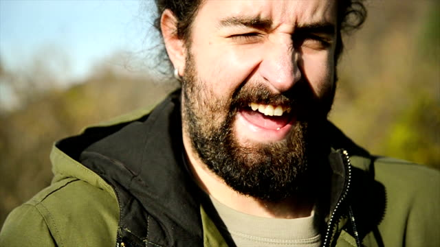 Man laughing. Close up.