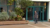 Man leaving office building