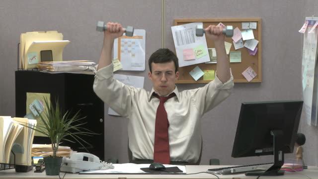 man lifting weights at work