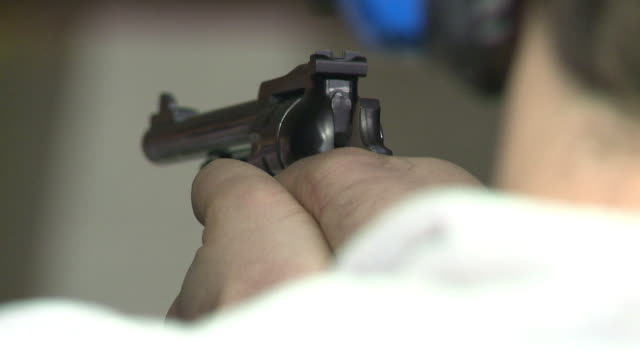 Man Loads Revolver and Fires at a Target at Maryland Small Arms Range on January 20 2013 in Upper Marlboro Maryland