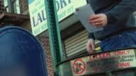 CU Man looking at letters and then throwing them in dustbin / Brooklyn, New York, USA