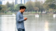 Man looking at mobile phone on the waterfront