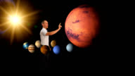 Man looking at the planets