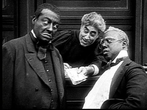 1916 B&W MS man looking disapprovingly as judge gives other man money