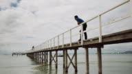 Man looking the sea at Sorrento bay, Mornington Peninsula, Victoria, Australia