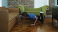 man looking under the couch for his keys