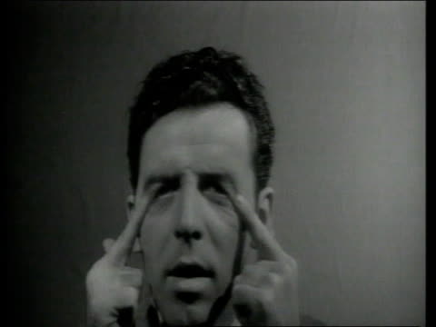 1943 MONTAGE Man looks at himself in mirror through various distortions
