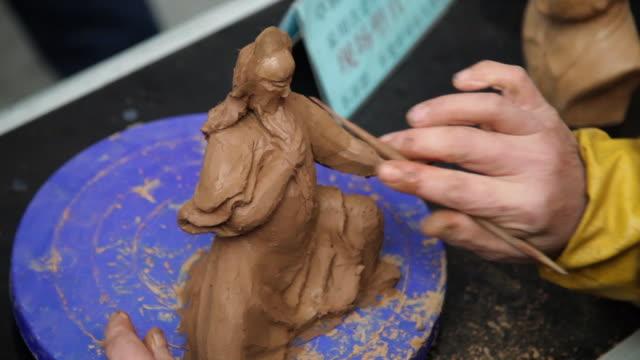 CU Man making clay figure souvenirs / xi'an, shaanxi, china
