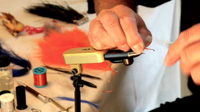 Man making fishing lures